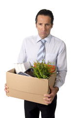 senior businessman carrying office box fired from work depressed