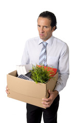 senior businessman carrying office box fired from work sad