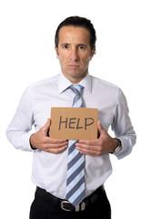 senior businessman holding help sign in overwork stress concept