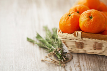 Tangerines in a wicker basket for Christmas