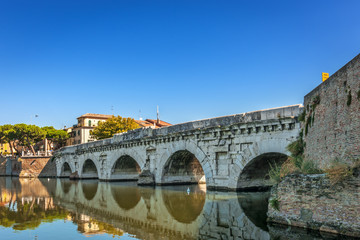 Historical roman Tiberius bridge over Marecchia river in Rimini