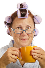 Cheerful Middle-aged Woman With Hair Curlers and Coffee Cup