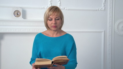 beautiful woman reading a book, slow motion, dolly 2
