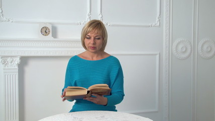beautiful woman reading a book, slow motion, dolly 1