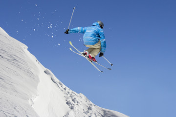 Jumping freestyle skier