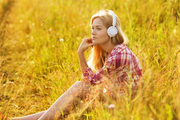 Happy girl listening to music on headphones
