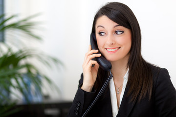 Smiling businesswoman at the phone