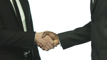 Hand shake of two businessmen, crane shot