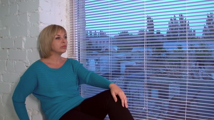 beautiful woman sitting near the window, doly, slow motion