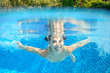 Underwater child swims in pool, girl swimming, kids sport