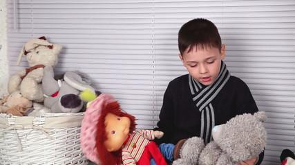 boy playing with soft toys, Nikolaev, Ukraine 2