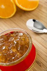 Orange marmalade in a small ramekin dish