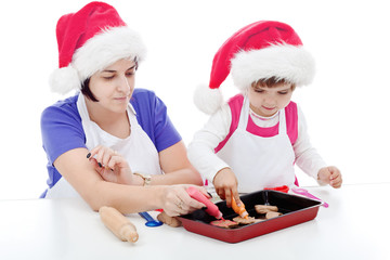 Mother and daughter preparing cookies