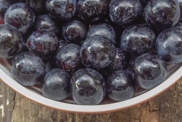 Black grape in plate