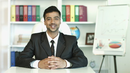 The indian businessman make a presentation, smile and looking