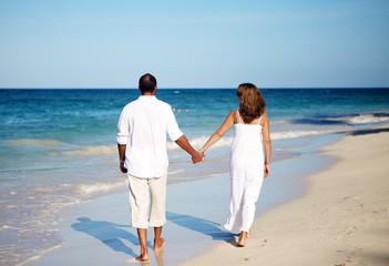 Romantic couple walking on beach