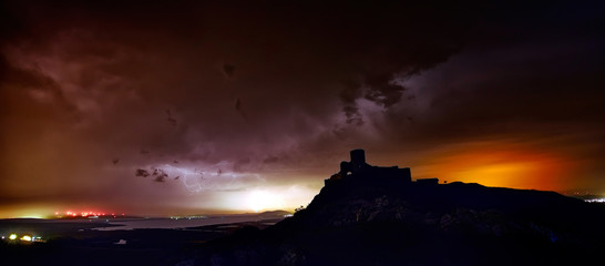 lightening strike over Enisala fortress, Dobrogea, Romania