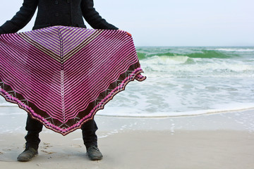 Girl in a shawl on a sea bank