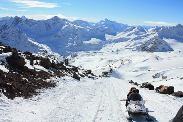Snowmobile in the high snowy mountains