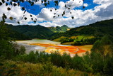 flooded church in toxic red polluted  lake due to copper mining,