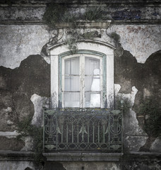 old rusty balcony with a closed window