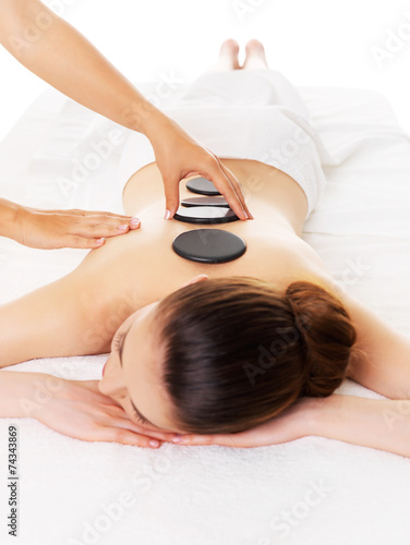 canvas print picture Woman having hot stone massage in spa salon.