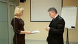 beautiful woman and elderly businessman swear in the office 2
