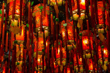 Closeup of many lit red lamps/lanterns in a temple