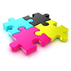 Four CMYK jigsaw puzzle pieces. Isolated on a white background.