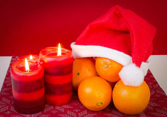 Christmas composition with orange and candles