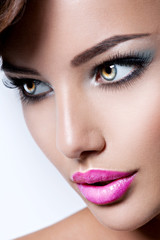 face of beautiful woman with pink color lipstick on the lips
