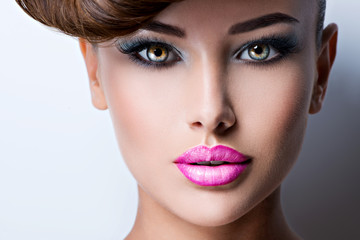face of beautiful woman with fashion vivid color makeup