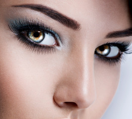 model's face of  woman with beautiful blue eyes with long eyelas