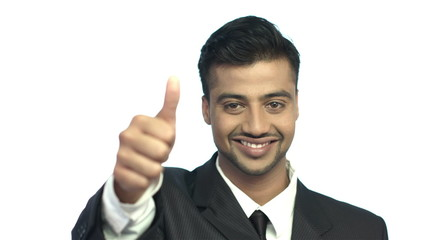 The indian businessman show thumb up and look to the camera