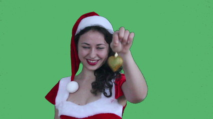 Young Santa Girl close up showing heart decoration green screen