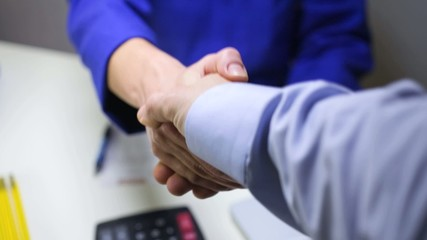handshake between a workshop manager and a client