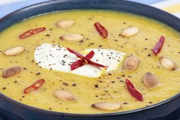 Closeup of a bowl of pumpkin soup.