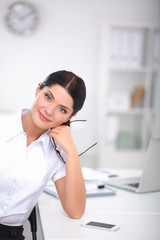 Attractive businesswoman sitting  in the office