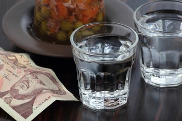 Closeup of two shots of vodka.