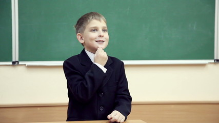 little boy meets at a lesson near blackboard at school 2