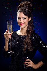 Portrait of beautiful girl in evening dress with wine glass. New