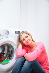 Housework: young woman doing laundry