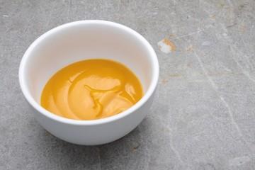 mango fruit puree in white bowl