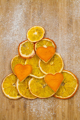 Christmas tree made of dried orange slices and hearts of the pee