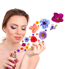 Young woman applying perfume with flower aroma, isolated
