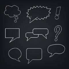 Speech bubbles on blackboard