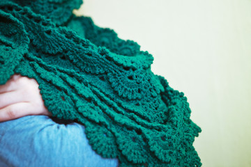 Green knitted shawl