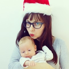 Mother santa claus kiss baby