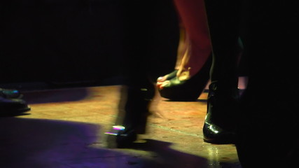 Dancing crowd legs at the disco