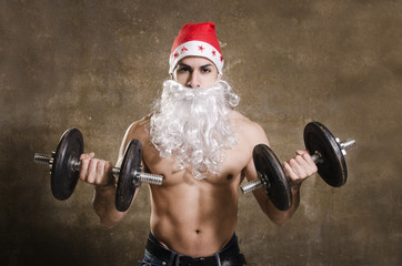 Strong Santa Claus training biceps